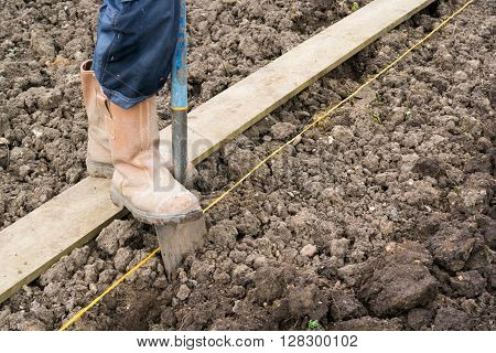 Preparing and digging soil on an allotment