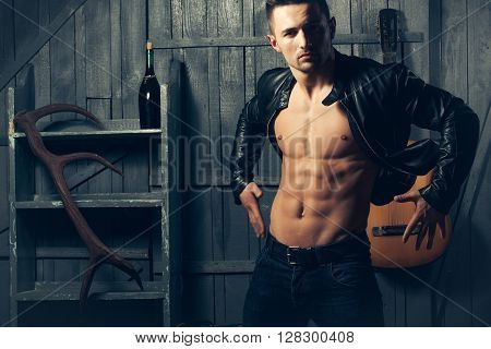 Muscular Man With Guitar