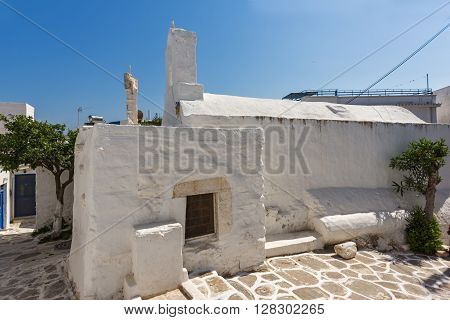 White chuch and street in town of Parakia, Paros island, Cyclades, Greece