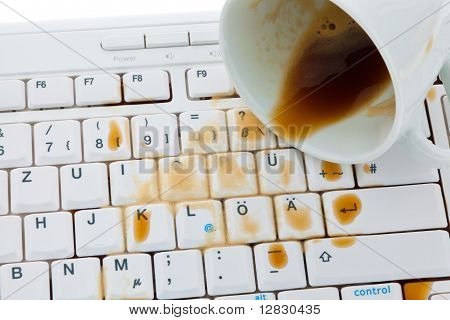 Cup of coffee spilled on keyboard.