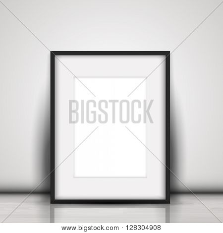 Blank picture leaning against a white wall