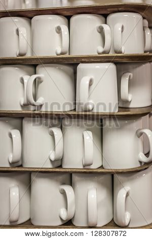 Pile of clean tea cups on a table in a self service breakfast restaurant in a hotel