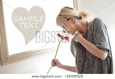 Fashion woman smelling gerbera flower with place for text