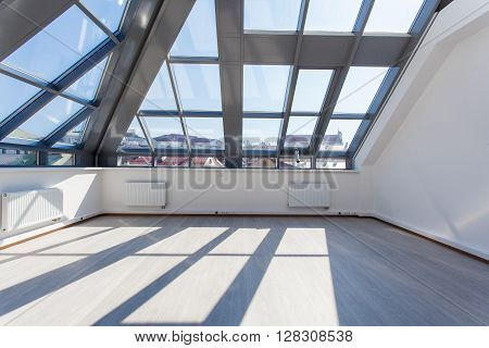 The Spacious Interior Room Unfurnished With A Glass Ceiling