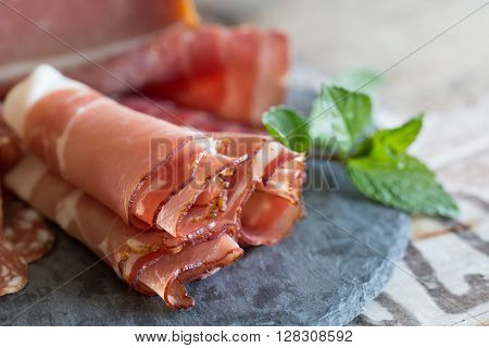 a selection of fine ham on a wooden ground