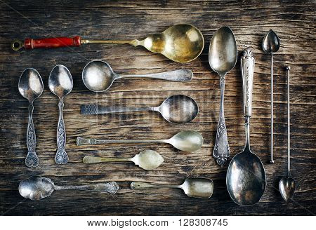 Vintage spoons on wooden background. Top view