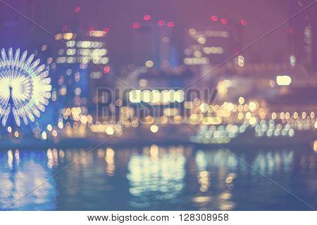 Unfocused Bokeh Night Harbor Lights Background With Ferris Wheel