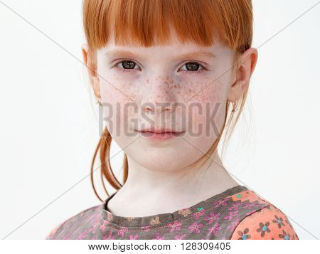 Very Beautiful Red-haired Little Girl With Freckles Serious