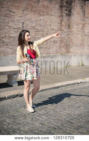 Young Woman Tourist Pointing Out Outdoor