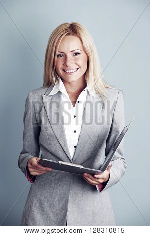 Business woman in gray suit with folder