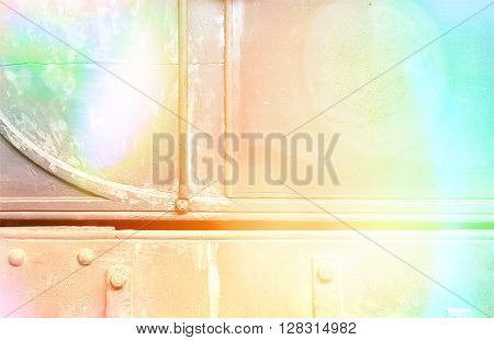 Side of old railway carriage with splashes of color for effect.