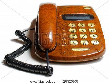 brown phone with buttons on a white table