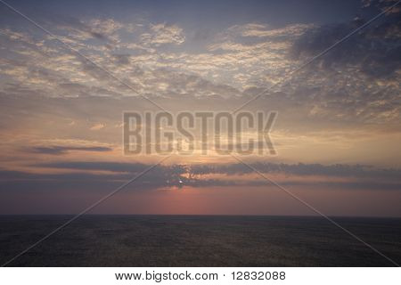 Scenic Bald Head Island North Carolina landscape of sunrise over ocean.
