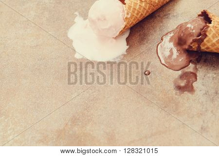 Ice cream melting on the table