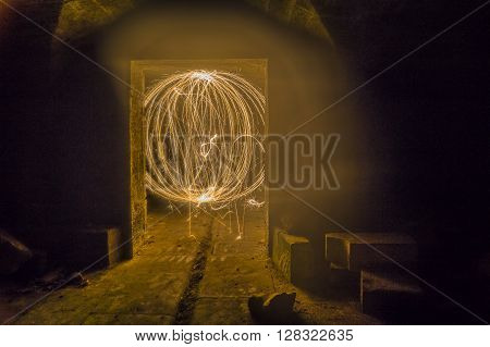Dungeon fireball created with sparklers in ruined building