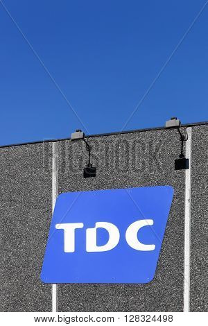 Aarhus, Denmark - May 1, 2016: TDC is a Danish telecommunications company and itis the largest telephone company in Denmark with 8.5 million customer relations within telephony, broadband, and television