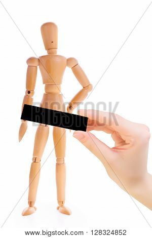 Wooden man with a hand holding a black rectangle. Concept of censorship and parental control. Isolated on white