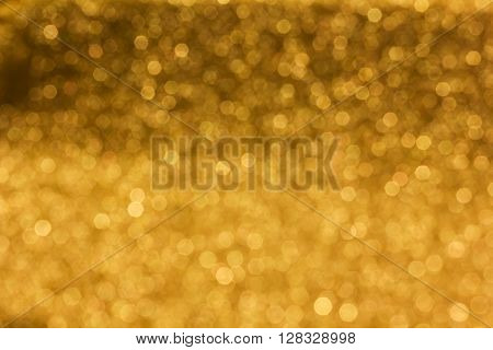 Spark And Glow Shining Bokeh Light In Golden Colour Tone For Abstract Luxury Background