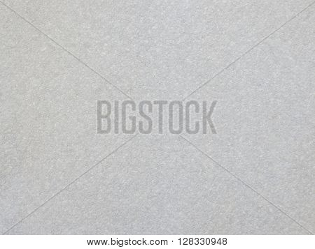 Closeup of a section of textured paper.