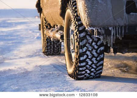 Close up of truck on ice covered road.