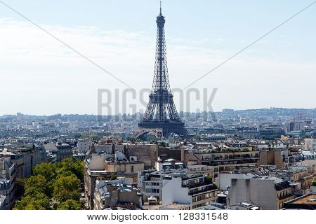 Color DSLR wide angle stock image of the landmark, tourist destination Eiffel Tower, Paris, France, with the city skyline in the foreground and background. Horizontal with copy space for text