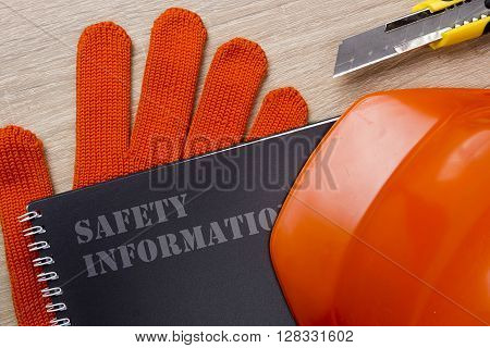 Industrial orange helmet and protective gloves for compliance with safety and the safety