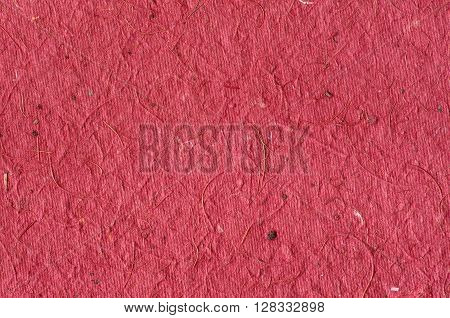 Red background - texture of decorative colored paper