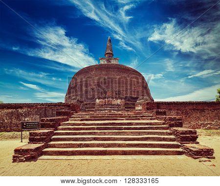 Vintage retro effect filtered hipster style image of Sri Lankan tourist landmark - ruins of Rankot Vihara - Buddhist dagoba (stupa).  Pollonaruwa, Sri Lanka