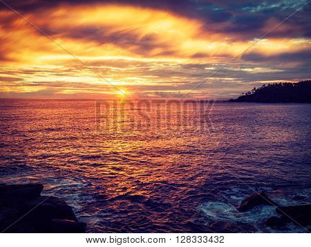 Vintage retro effect filtered hipster style image of romantic ocean sunset with dramatic sky. Mirissa, Sri Lanka