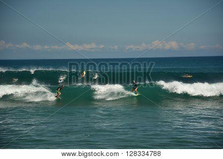 BALANGAN BEACH BALI - 25 MARCH: Surfers conquer the wave on Balangan beach Bali March 25, 2016 on Balangan beach Bali