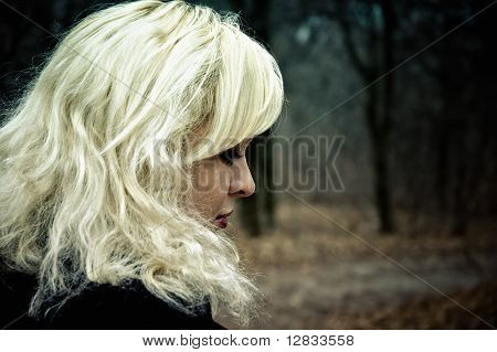 Half-face Portrait Of Beautiful Young Blonde