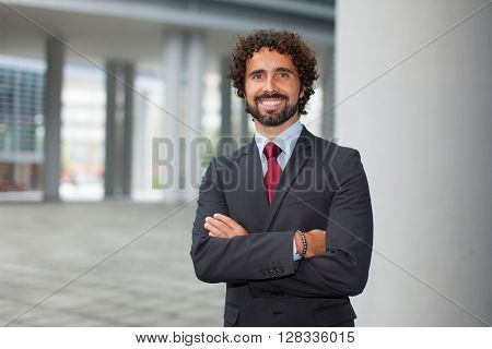 Portrait of an handsome smiling business man