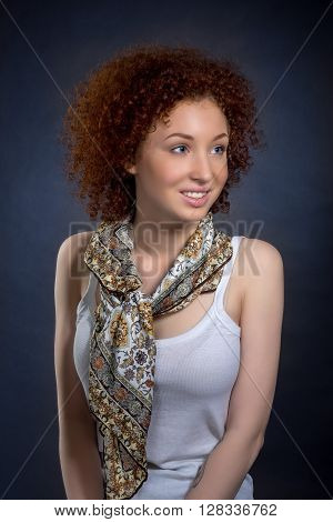 Portrait Of Beautiful Young Woman With Red Curly Hair And Blue Eyes In White Shirt With A Scarf, Stu