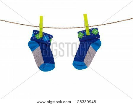 baby socks hanging on a clothesline isolated on white
