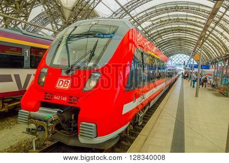 DESDREN, GERMANY - MARZO 23, 2016: Modern red HB train waitting for passengers,  departure of the train is coming,