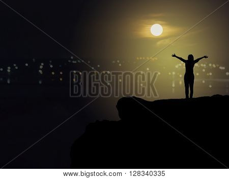 Women Silhouette On Cliff With Dollar Symbol On Blurred City Topview