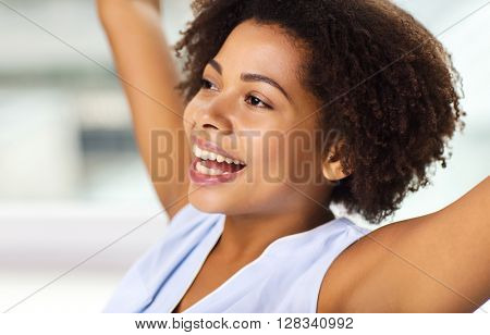 people, race, ethnicity and success concept - face of happy african american young woman celebrating victory