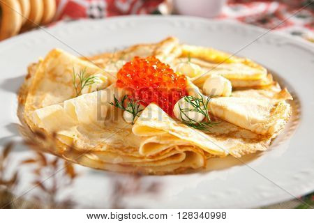 Pancakes with Red Caviar and Butter