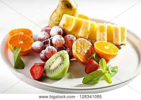 Yummy Summer Fruit Dish Dressing with Powder and Mint