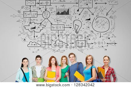 education, school and people concept - group of smiling teenage students with folders and school bags over background with scheme drawing