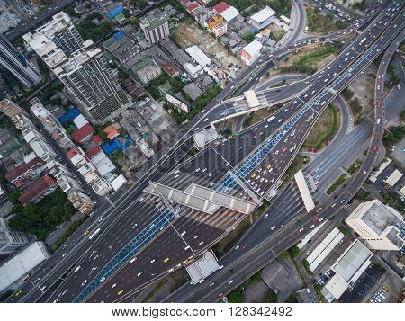 Aerial View Of Traffic Junction And Transportation Road In City, Top And Birdeyes View Shot 90 Degre