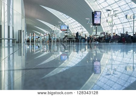 DUBAI - APRIL 06: Passenger lobby in Dubai International Airport on April 6 2016 in Dubai UAE. It's world largest building by floor space and world largest airport terminal.