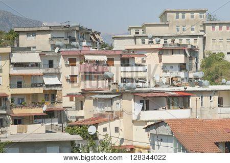 Residential buildings in Gjirokaster Albania, sunlit, summer