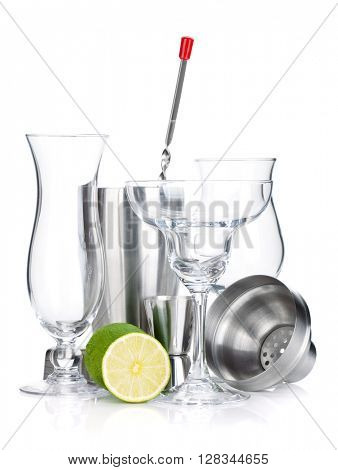 Cocktail shakers, glasses, utensils and lime. Isolated on white background