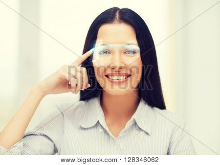 business, education and technology concept - smiling woman pointing to virtual futuristic glasses