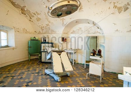 TALLINN, ESTONIA - AUGUST 6: View on surgery room interior with operation table in soviet jail in Tallinn Estonia. August 2015