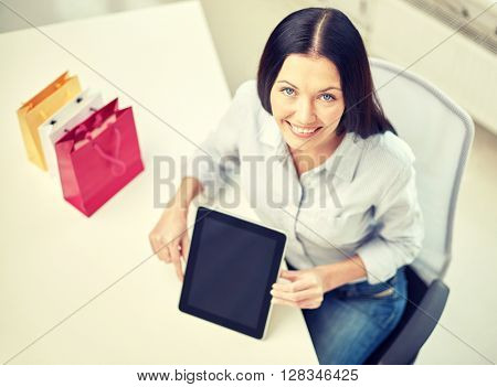 business, technology, communication and people concept - close up of woman with tablet pc computer at office or home