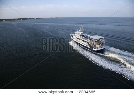 Ferry boat transporting passengers across Atlantic Ocean near Bald Head Island, North Carolina.