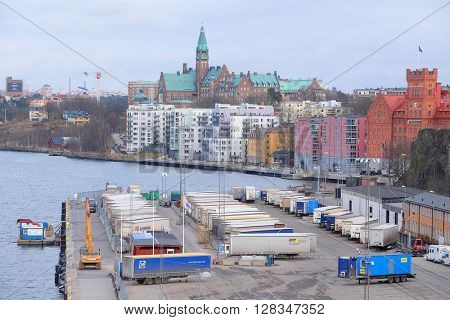 Stockholm, Sweden - March, 16, 2016: trucks on a parking in Stockholm harbour, Sweden