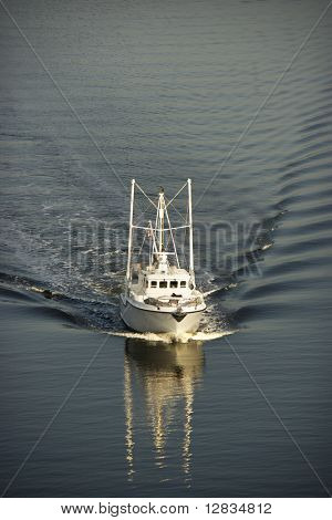 Aerial view of trawler fishing boat at sea.